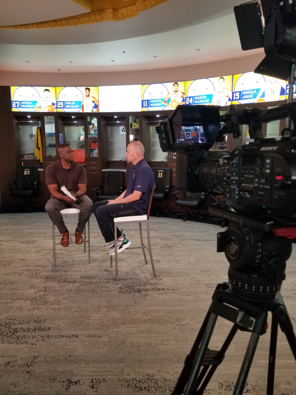 Filming a sit down interview with Altitude's Chris Dempsey and Denver Nuggets Coach Michael Malone.