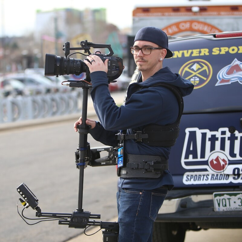Alan Meyer wearing steadicam at tailgate event before Denver Nuggets Playoffs game.