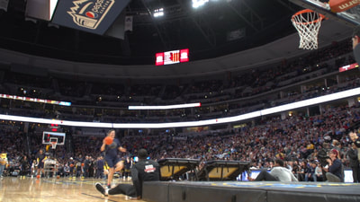Alan Meyer shooting footage of dunk squad during Nuggets game